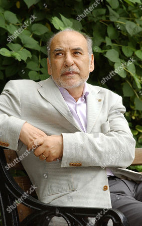 """TAHAR BEN JELLOUN Moroccan Tahar Ben Jelloun, author of """"This Blinding Absence of Light"""", winner of this year's International IMPAC Dublin Literary Award, poses in downtown Dublin, Ireland, . The IMPAC is the world's richest literary prize for a single work of fiction published in English. He will get three-fourths of the $120,000 prize, while the other quarter will go to Linda Coverdale, who translated the book into English"""