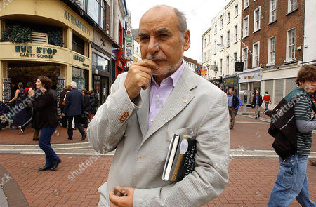 """TAHAR BEN JELLOUN Moroccan Tahar Ben Jelloun, author of """"This Blinding Absence of Light,"""" winner of this year's International IMPAC Dublin Literary Award, stands in downtown Dublin, . The IMPAC is the world's richest literary prize for a single work of fiction published in English. He will get three-fourths of the $120,000 prize, while the other quarter will go to Linda Coverdale, who translated the book into English"""