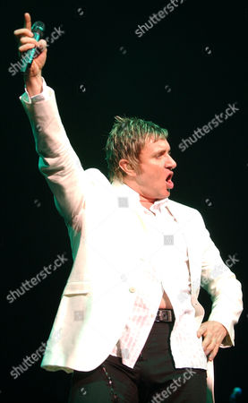 DURAN DURAN LEBON British rock group Duran Duran's lead vocalist Simon LeBon strikes a pose during the group's first concert in 18 years in Tokyo . The 1980's rock group members performed together for the first time following their last performance in Live Aid 18 years ago