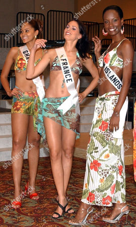 Stock Image of Menaye Donkor, Miss Ghana; Laetitia Bleger, Miss France and Stacey-Ann Kelly, Miss Cayman Islands,left to right pose for photographers at a hotel in Quito, today the session of Misses in swimsuit was suspended by the rain only a group of them can be photographied . Quito, . The contestants will be participating in the Miss Universe beauty pageant on June 1 in Quito, Ecuador