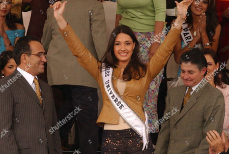 Amelia Vega Miss Universe 2003, greets the audience upon her arrival to the Middle of the World Monument in Quito, Ecuador
