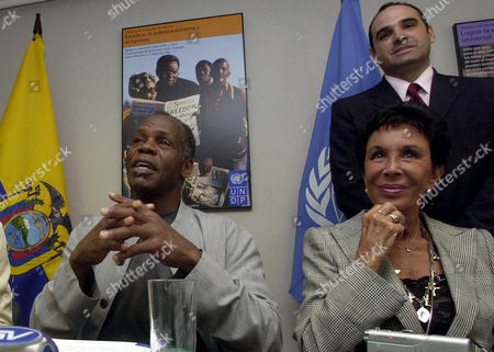 GLOVER BELAFONTE Actor and U.N. Goodwill Ambassador Danny Glover, left, talks about the reduction of poverty during his visit Quito, Ecuador . Also seen at right is actress Julie Belafonte. Person seen in background is unidentified