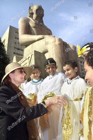 Celia Sandys, grand daughter of Winston Churchill, Britain's wartime Prime Minister, chats with Egyptian boys wearing Pharaonic dress during the official inauguration of the Peace Camp Program at the Egyptian museum in Cairo