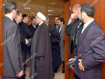 ROHANI SOLANA Secretary General of the Supreme National Security Council of Iran Hassan Rohani, center inside doorway, shakes hands with European foreign policy chief Javier Solana, second left, after a meeting at the European Council building in Brussels, . Rohani is in Brussels to meet with EU officials and to discuss EU-Iran relations