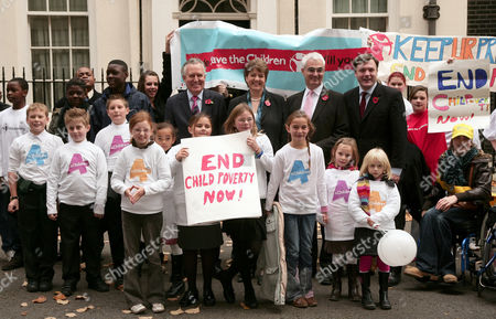 Peter Hain (1stl), Jane Kennedy, Chancellor, Alistair Darling (3rd l) and Ed Balls (4th l), with children