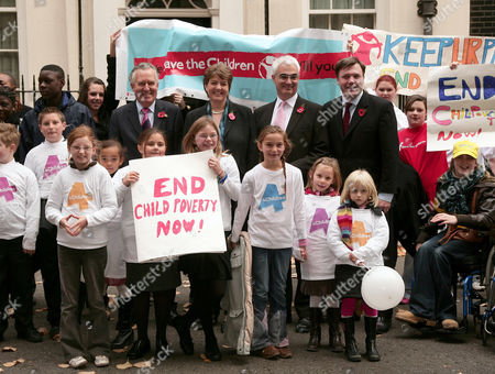 Peter Hain (1st l), Jane Kennedy, Chancellor, Alistair Darling (3rd l) and Ed Balls (4th l), with children