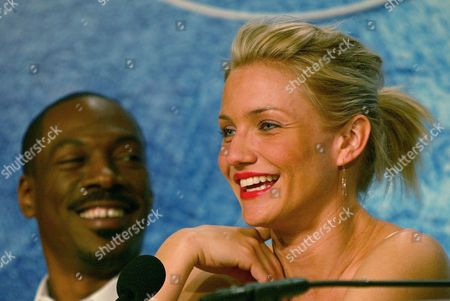 "Stock Photo of DIAZ MURPHY American actress Cameron Diaz, right, and American actor Eddie Murphy, smile during a NEWS conference for their animated film ""Shrek 2,"" in competition, directed by New Zealander Andrew Adamson, American Kelly Asbury and American Conrad Vernon, at the 57th International Film Festival in Cannes, southern France"