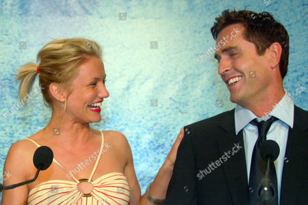 "Stock Picture of DIAZ EVERETT American actress Cameron Diaz, left, and British actor Rupert Everett, right, smile during a press conference for their animated film ""Shrek 2,"" in competition, directed by New Zealander Andrew Adamson, American Kelly Asbury and American Conrad Vernon, at the 57th International Film Festival in Cannes, southern France"