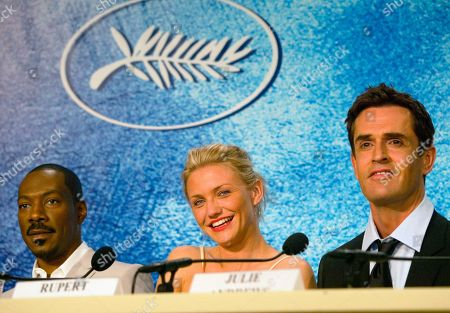 "DIAZ MURPHY EVERETT American actress Cameron Diaz, center, American actor Eddie Murphy, and British actor Rupert Everett, right, smile during a press conference for their animated film ""Shrek 2,"" in competition, directed by New Zealander Andrew Adamson, American Kelly Asbury and American Conrad Vernon, at the 57th International Film Festival in Cannes, southern France"