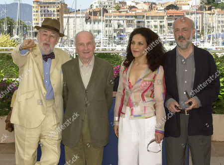 """BLIER French actor Philippe Noiret, left, Michel Bouquet, 2nd left, Farida Rahoudaj, 2nd right, and French Bertrand Blier, right, pose during a photo call for their film""""Les Cotelettes,"""" (The Rips) in competition, at the 56th Film Festival in Cannes"""