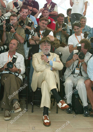 """NOIRET French actor Philippe Noiret, poses among Festival photographers during a photo call for his film""""Les Cotelettes,"""" (The Rips) in competition, directed by French Bertrand Blier, at the 56th Film Festival in Cannes"""