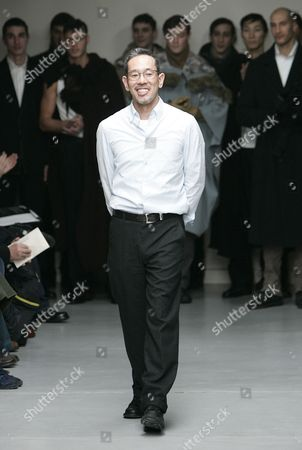 TAKIZAWA Japanese designer Naoki Takizawa acknowledges applause at the end of his men's fall-winter 2005-2006 pret-a-porter collection for Issey Miyake presented in Paris