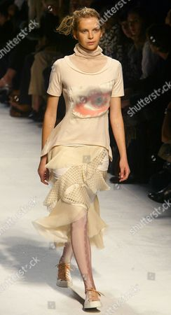 A model presents a beige t-shirt with a matching dotted skirt by Japanese fashion designer Naoki Takizawa for Issey Miyake's spring-summer 2005 ready-to-wear fashion collection, presented, in Paris