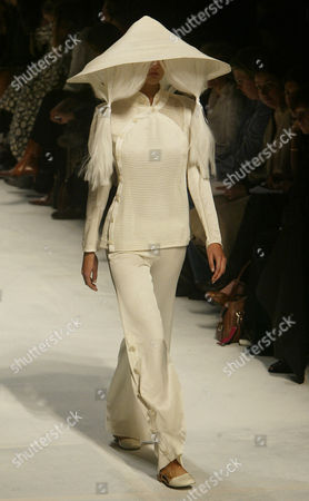 A model presents a cream ensemble with a tricot top and matching trousers by Japanese fashion designer Naoki Takizawa for Issey Miyake's spring-summer 2005 ready-to-wear fashion collection, presented in Paris