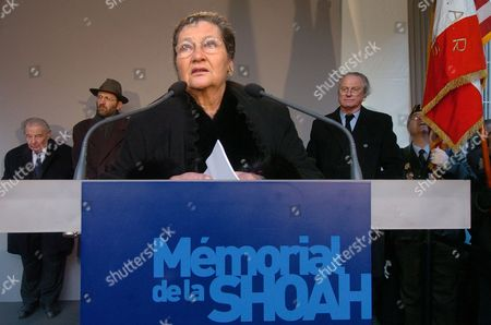 Former French Cabinet Minister Simone Veil, herself an Auschwitz survivor, foreground, delivers a speech during the inauguration of the Paris Memorial for Holocaust victims, as President of the Association of People Deported to Auschwitz Henry Bulawko, French rabbi Gilles Bernheim, rear left, and President of the Memorial Eric de Rothschild, right, listen. The Memorial comprises pale stone walls engraved with the names of 76,000 people deported from France to Nazi death camps during WWII, in central Paris' jewish district. The Wall of Names is part of the renovated Holocaust Memorial and will be inaugurated by French President Jacques Chirac on Jan. 25