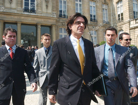 FERRY French Education Minister Luc Ferry, center, leaves the Elysee Palace after the weekly cabinet in Paris, . The French government's pension reform was put before the cabinet on Wednesday, as teachers who have been striking on and off for weeks, wanted its withdrawal. Others are police officers