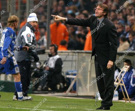 TROUSSIER ROUX New coach of the Marseille League One soccer team Philippe Troussier, right, gestures as Auxerre's coach Guy Roux, center, wearing a white hat, looks on during their French League one soccer match in Marseille, southern France, . Marseille lost the match 1-0