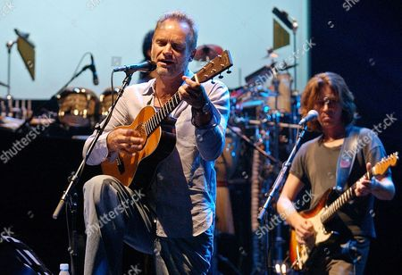 "STING MILLER British rock star Sting, left, rehearses with guitarist Dominic Miller, right, at the Olympia music hall in Paris. Sting is to perform a single concert at the Olympia on Monday, Sept. 22 to present his new album ""Sacred Love"