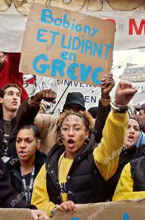 Students holding banners and placards gesture as they shout slogans during a demonstration to protest decentralization and a proposal to harmonize diplomas at French universities with those at other schools in Europe, in Paris. Apparently retreating in the face of student strikes, France's Education minister Luc Ferry said last Saturday, Nov. 22 he has no immediate plans to decentralize universities