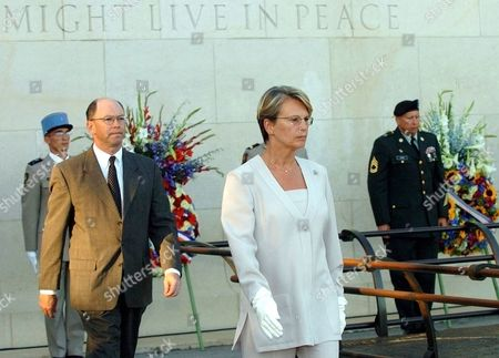 ALLIOT MARIE WOLF French Defense Minister Michele Alliot-Marie, center, and Alex Wolf, 2nd from left, the No 2 at the U.S embassy in Paris arrive at a memorial ceremony at the U.S. cemetery in Draguignan, southern France, . France opened a weekend tribute to the soldiers who helped liberate its land from Nazi Germany's grip in one of the least rememebered military operations of World War II, the Allied invasion of the Riviera