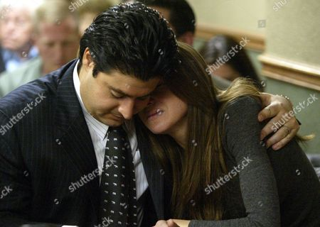Stock Picture of CRISTALLI MURPHY Defendant Sandy Murphy, right, reacts along with her attorney Michael Cristalli,left, as the judge re-reads the jury's verdict in Clark County District Court in Las Vegas. Murphy and co-defendant Rick Tabish were acquited of murder charges during thier retrial for the 1998 death of casino executive Ted Binion