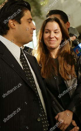 Stock Photo of CRISTALLI MURPHY Defendant Sandy Murphy, right, speaks to the media along with her attorney Michael Cristalli, left, in front of the Clark County District Court in Las Vegas. Murphy and co-defendant Rick Tabish were acquited of murder charges during thier retrial for the 1998 death of casino executive Ted Binion