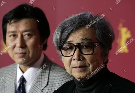 """Japanese director Yoji Yamada, right, and producer Takeo Hisamatsu poses at a photo call prior to a news conference about their movie """"Kakushi Ken-Oni No Tsume"""" at the 55th International Berlinale film festival in Berlin on . Twenty one movies take part in competition for the Golden and Silver Bear awards from Feb. 10 until Feb. 20, 2005"""