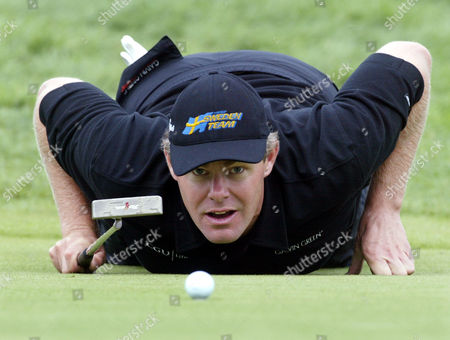 JOAKIM HAEGGMAN Joakim Haeggman from Sweden eyes the ball during his first round of the BMW International Open in Eichenried near Munich, southern Germany, on Thursday, Aug. 26. 2004. The golf tournament with a prize of 1.8 Million Euro, ($2,176,000) takes place in Eichenried until August 29