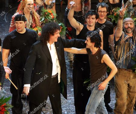 """Stock Photo of MELCHER, MAY Guitar player Brian May, left, of British rock group Queen embraces actor Alex Melcher, right, on the stage after the premiere of their musical """"We will rock you"""" in Cologne, Germany"""
