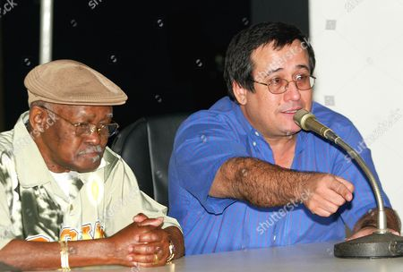 CUBA GRAMMY Cuban singer Ibrahim Ferrer, left, and Deputy Culture Minister Abel Acosta are seen during a press conference in Havana, Cuba. Acosta said that the US authorities have refused to give visas to Cuban artists invited to participate at the Grammy awards held in Los Angeles on Feb. 8