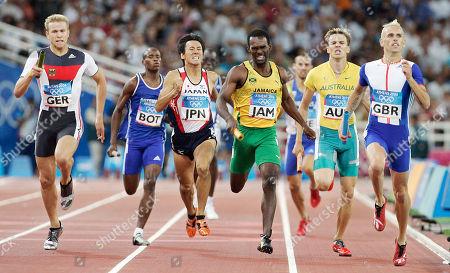Stock Image of Running in a heat of the 4 x 400 relay are, left to right, Germany's Bastian Swillims, Botswana's Kagiso Kilego, Japan's Mitsuhiro Sato, Jamaica's Davian Clarke, Australia's Mark Ormrod, and Britain's Matthew Elias at the 2004 Olympic Games in Athens, Greece