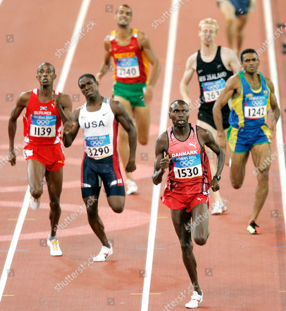 Running in a qualifying heat of the 800m are, left to right, Jean Patrick Nduwimana of Burundi, Jonathan Johnson of the U.S., Joao Pires of Portugal, Wilson Kipketer of Denmark, Jason Stewart of New Zealand, and Osmar Santos of Brazil at the 2004 Olympic Games in Athens, Greece