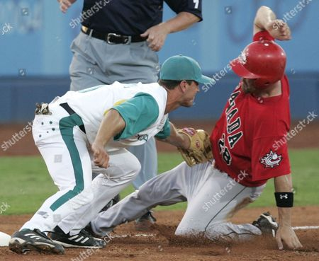 WILLIAMS STEWART Australian third baseman Glenn Williams, left, tags out Canada baserunner Andy Stewart at third base in the second inning, at the 2004 Olympic Games in Athens, Greece