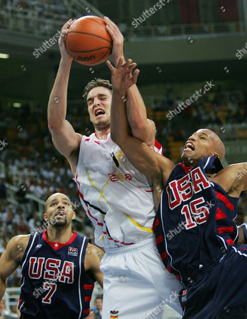 GARBAJOSA JEFFERSON BOOZER Spain's Jorge Garbajosa, center, is defended by the USA's Richard Jefferson (15) during the second quarter of their game at the Olympic Indoor Hall during the 2004 Olympic Games in Athens, Greece on . At left is the USA's Carlos Boozer (7