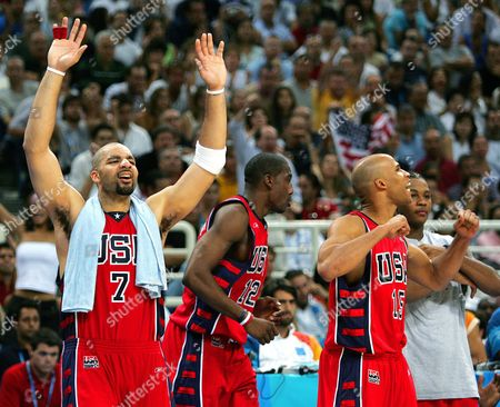 BOOZER STOUDEMIRE JEFFERSON Members of the USA basketball team react at the end of a 104-96 win over Lithuania in the bronze medal game at the Olympic Indoor Hall during the 2004 Olympics in Athens, Greece on . From left: Carlos Boozer (7), Amare Stoudemire (12) and Richard Jefferson (15