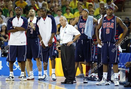 ANTHONY Coach Larry Brown, center, and members of the United States team, left to right, Lebron James, Carlos Boozer, Amare Stoudemire, Shawn Marion, Shawn Marion, Emeka Okafor and Carmelo Anthony watch the closing seconds of a 94-90 loss to Lithuania in a preliminary round game at the Helliniko Indoor Arena in Athens during the 2004 Olympics Games