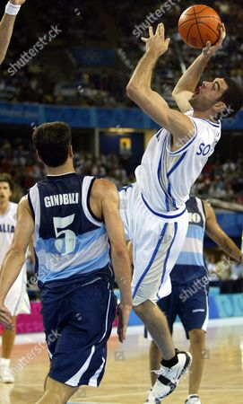 SORAGNA GINOBILI Italy's Matteo Soragna, right, shoots over Argentina's Emanuel David Ginobili in the second half of a preliminary round game at the Helliniko Indoor Arena in Athens during the 2004 Olympics Games, . Italy defeated Argentina 76-75