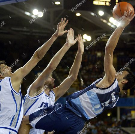 GINOBILI GARRI GALANDA Argentina's Emanuel David Ginobili, right, hits a shot at the buzzer ending the first quarter over Italy's Luca Garri, left, and Giacomo Galanda in a preliminary round game at the Helliniko Indoor Arena in Athens during the 2004 Olympics Games