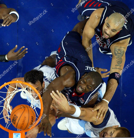 WOLKOWYSKI USA'sDwyane Wade, Jr., center, is surrounded byy teammate Carlos Boozer, top right, and Argentina's Emanuel David Ginobili and Ruben Wolkowyski as he tips in a shot in their semi-final game at the Olympic Indoor Hall during the 2004 Olympics in Athens, Greece on . Argentina defeated USA 89-81