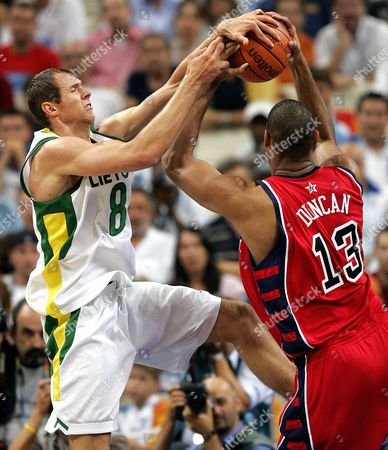 SISKAUSKAS DUNCAN Lithuania's Ramunas Siskauskas (8) battles for the ball with the USA's Tim Duncan during the fourth quarter of their bronze medal game at the Olympic Indoor Hall during the 2004 Olympics in Athens, Greece on