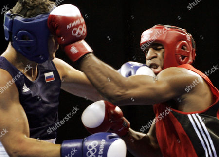 SOLIS FONTE ALEKSEEV Russia's Alexander Alekseev, left, and Cuba's Odlanier Solis Fonte exchange blows during the heavyweight boxing preliminaries in the 2004 Athens Summer Olympic Games at the Peristeri boxing hall in Athens . Solis Fonte won the match