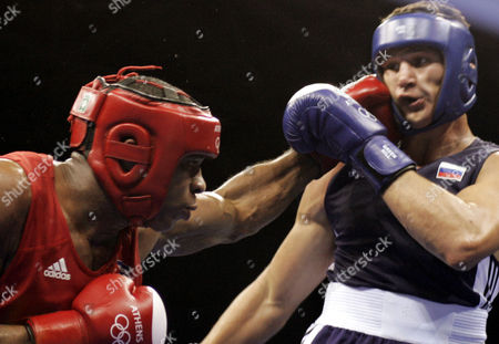 SOLIS FONTE ALEKSEEV Cuba's Odlanier Solis Fonte, left, lands a blow on Russia's Alexander Alekseev during the heavyweight boxing preliminaries in the 2004 Athens Summer Olympic Games at the Peristeri boxing hall in Athens . Solis Fonte won the match