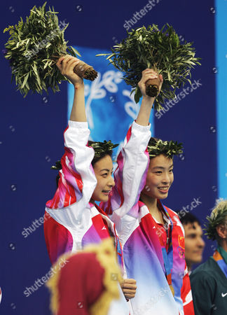 MINXIA GUO China's Guo Jing Jing, left, and Wu Minxia, celebrate after winning the gold medal in the Women's 3 meter synchronized springboard diving competition at the 2004 Olympic Games in Athens