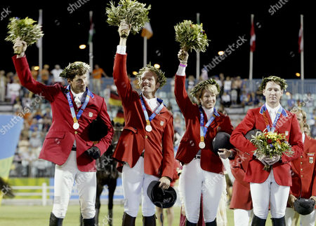 WARD USA equestrian jumping team members Chris Kappler, left, Peter Wylde, second left, Beezie Madden, second right, and McLain Ward, right celebrate their Silver medal in the 2004 Athens Olympics team jumping competition at the Markopoulo Equestrian center in Athens