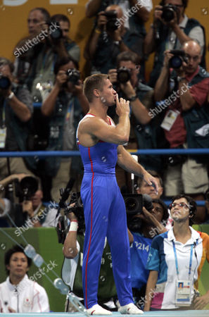 Russia's Alexei Nemov tries to quiet the crowd after completing his high bar routine during the men's gymnastics individual apparatus finals at the 2004 Summer Olympic Games in Athens, . The crowd in the arena loudly protested Nemov's score on the apparatus