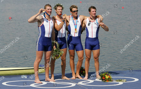 Britain's Steve Williams, James Cracknell, Ed Coode and Matthew Pinsent (right to left) pose on the podium after they won the gold medal in the Men's Four event at the 2004 Olympic Games in Schinias near Athens, Greece
