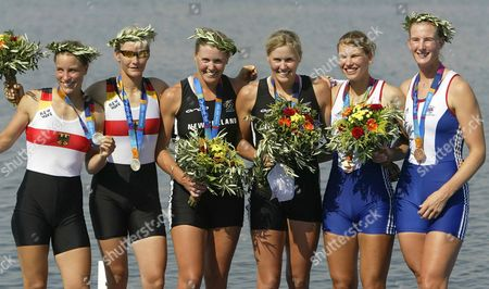 Silver medalists Germany's Britta Oppelt, left, and Peggy Waleska, gold medalists New Zealand's Georgina Evers-Swindell, third from left, and Caroline Evers-Swindell, and bronze medalists Britain's Elise Laverick and Sarah Winckless, right, pose on the podium after the Women's Double Sculls final at the 2004 Olympic Games in Schinias near Athens, Greece
