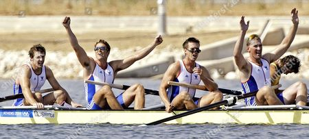 Britain's Steve Williams, James Cracknell, Ed Coode and Matthew Pinsent (left to right) react after they won the gold medal in the Men's Four event at the 2004 Olympic Games in Schinias near Athens, Greece