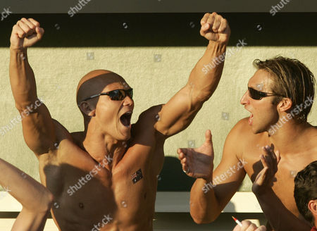 Australian swimmers Michael Klim and Ian Thorpe, right, cheer compatriot Brett Hawke in a 50-meter freestyle semifinal at the Olympic Aquatic Centre during the 2004 Olympic Games in Athens