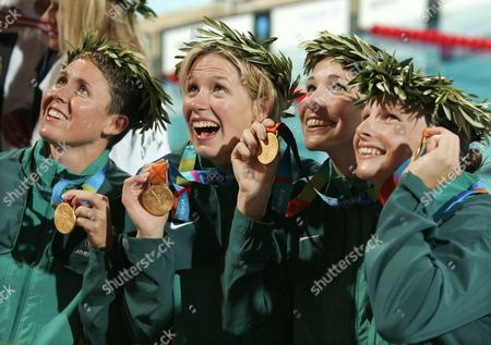The Australian 4 x 100-medley relay team from left; Petria Thomas, Jodie Henry, Giaan Rooney, and Leisel Jones celebrate with their gold medals at the Olympic Aquatic Centre during the 2004 Olympic Games in Athens